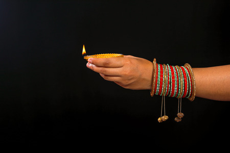 Indian Festival diwali , Lamp in hand Stock Photo