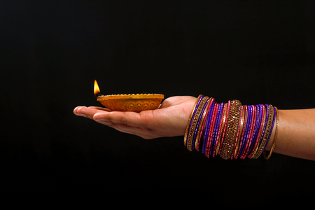 Indian Festival diwali , Lamp in hand Stock Photo