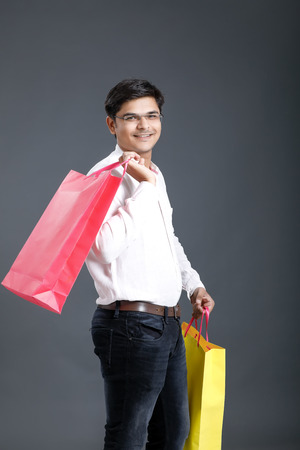 Indian man with shopping bags