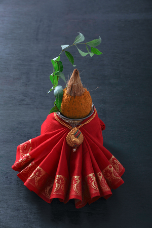 decorative kalash with coconut and leaf with floral decoration