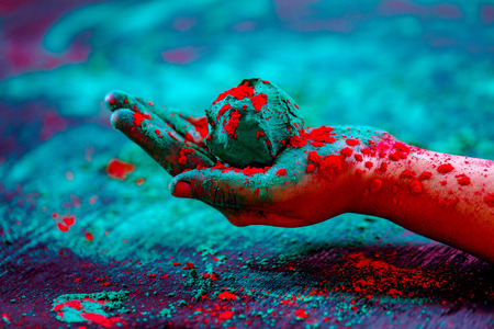 Color in hand , Indian Festival Holi