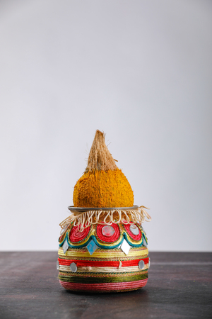 decorative kalash with coconut and leaf with floral decoration Stock Photo - 124684216