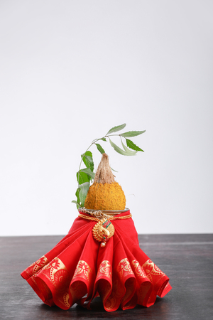 decorative kalash with coconut and leaf with floral decoration Stock Photo - 124684274