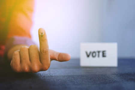 Indian Voter Hand with voting sign Stock Photo