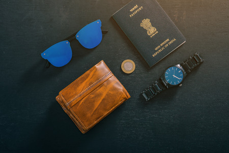 travel concept , Indian passport with watch , wallet , sun glass and indian coin Zdjęcie Seryjne