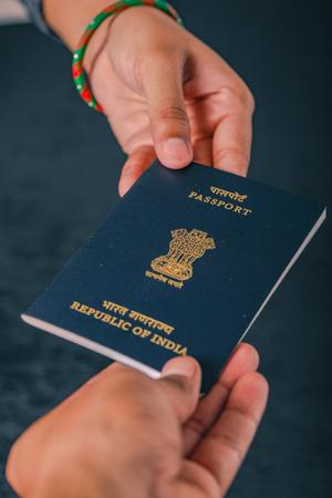 indian passport in hand , showing passport Zdjęcie Seryjne