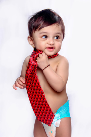 indian baby boy with tie Stock Photo - 124686150