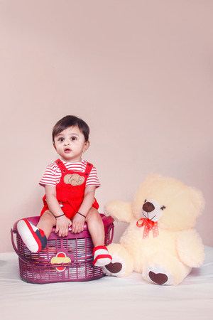 Indian Baby in red t shirt