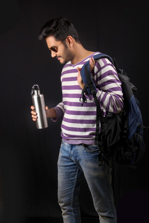 Indian man drinking water with bottle