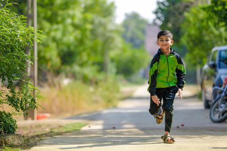 Indian child running at playground