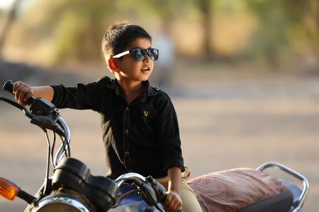 Cute Indian child wear sunglasses