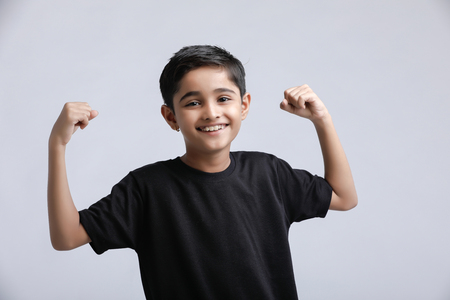 little Indian / Asian boy showing attitude over white background