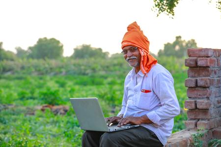 Indian rural farmer using laptop