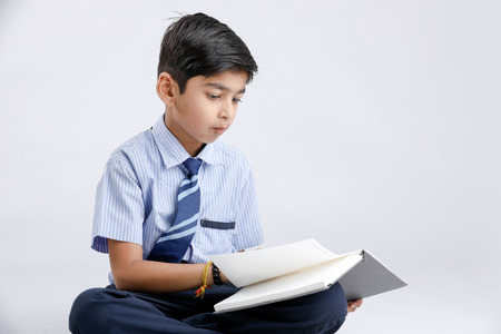 Indian / Asian school boy with note book and studying