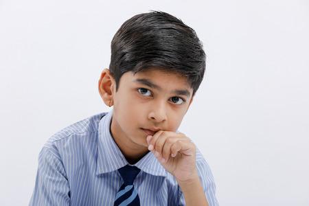 Cute little indian Indian / Asian school boy wearing uniform