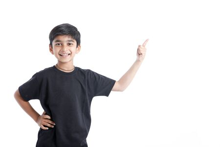 Indian child showing nice gesture with hand Stock Photo