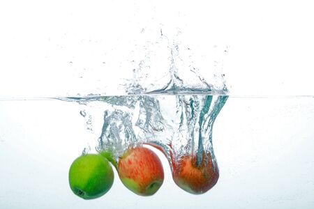Falling Apple Into Clean Water