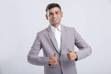 Young Indian Man Wearing suit and showing thumps up 版權商用圖片