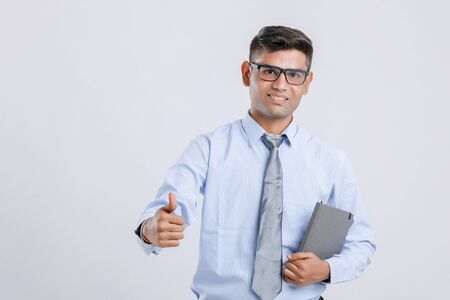 Indian Man Showing Thumps Up And  Holding Book in hand