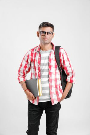 Indian college boy with Holding bag and Books