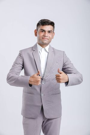 Young Indian Man Wearing suit and showing thumps up