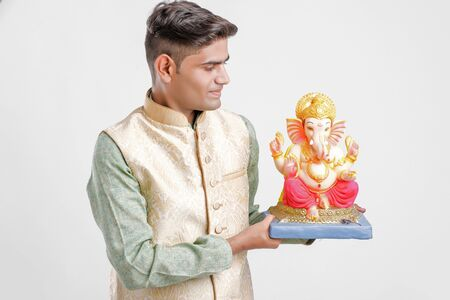 Young Indian man with Lord Ganesha , Celebrating Ganesh festival Stock Photo