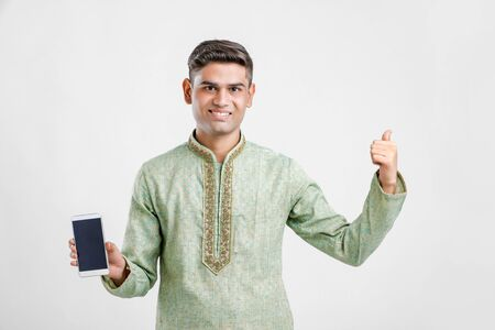 Young Indian Man In Ethnic wear and Showing Smartphone
