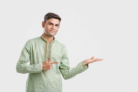 Indian man in ethnic wear and Showing Direction