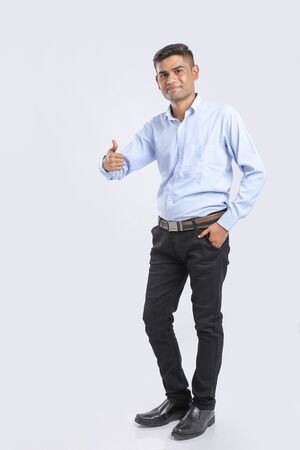 Young Indian Man Wearing suit and showing thumps up Foto de archivo