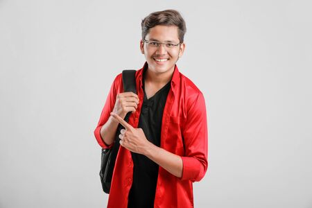 Handsome Indian / Asian college male student carrying bag 스톡 콘텐츠 - 128478315