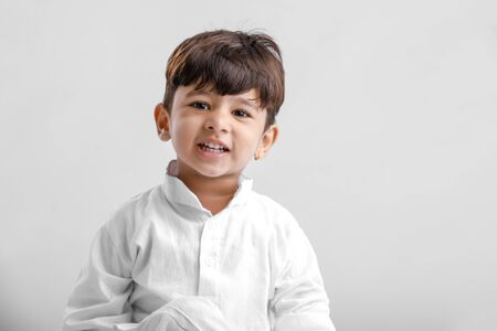 Indian little boy in Traditional Wear and Showing multi pal expression