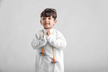 Indian Little Boy in traditional wear and praying Stock Photo