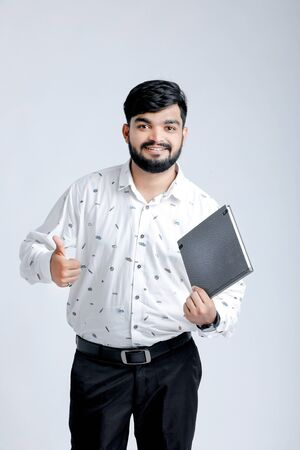Happy smiling student with his notebook Banco de Imagens