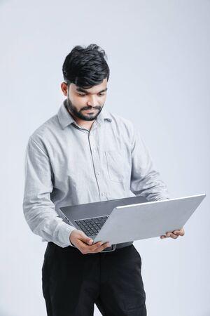 Young Indian  Asian man working on laptop Banco de Imagens