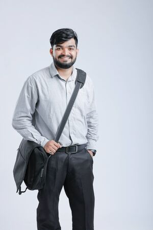 Young Indian male model standing and holding the office bag