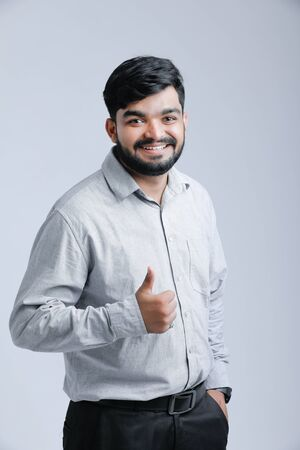 Indian  Asian young man showing thumbs up or ok sign Banco de Imagens