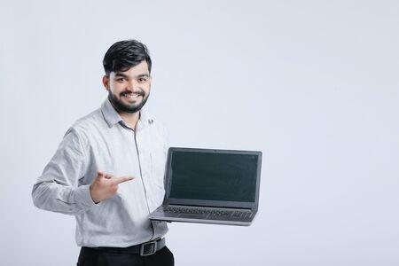 Young Indian  Asian man showing laptop screen Banco de Imagens