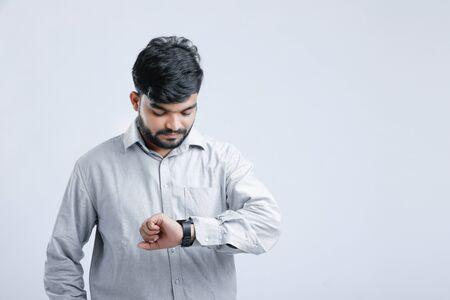 Young indian man watching time in wrist Watch Banco de Imagens