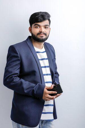 Young indian  Asian man using mobile Banco de Imagens