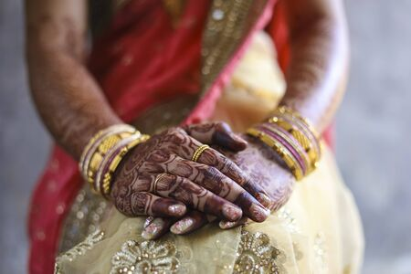 Indian wedding ceremony : bangle in bridal hand with mehandi design