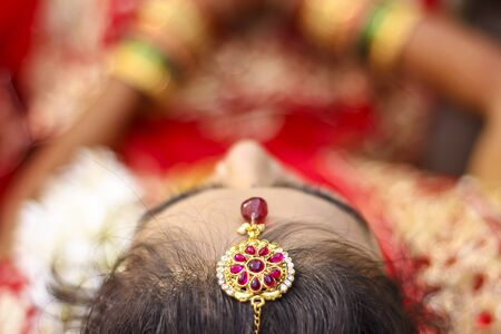 Indian bridal showing wedding hair style and head jewelry