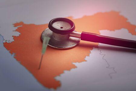 corona virus concept , Maharashtra map marked with syringe