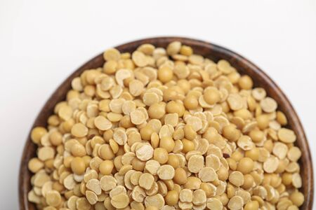 pigeon pea also known as toor dal in wooden bowl. Stock Photo