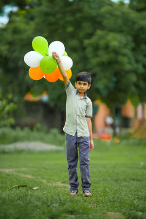 cute little indian boy with tri color balloons and celebrating Independence or Republic day of India Stock fotó