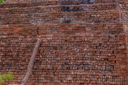 Old red brick wall background texture close up