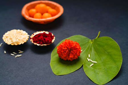 Indian festival dussehra , green leaf, rice and flowers