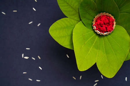Indian Festival Dussehra , green leaf and rice 免版税图像