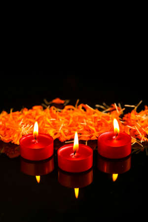 Indian festival diwali , candle on dark background