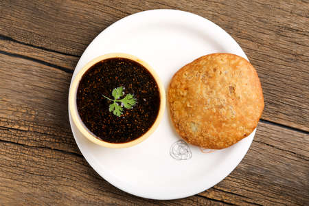 Kachori is a spicy snack from India also spelled as kachauri and kachodi. Served with tomato ketchup. Favorite Tea time snacks