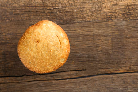Kachori and coriander on wooden background.kachori is a spicy snack from India also spelled as kachauri and kachodi. Served with tomato ketchup. Favorite Tea time snacks Stock Photo